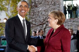 U.S. President Barack Obama, left, is welcomed by German Chancellor Angela Merkel prior to a meeting of the government heads of Germany, France, Italy, Spain and Britain in Berlin, Nov. 18, 2016.