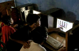 FILE - Indonesian youths browse their social media accounts at an Internet cafe in Jakarta, Indonesia.