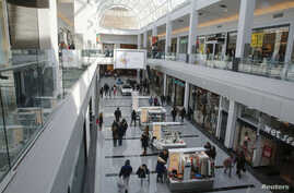 People are seen walking through Roosevelt Field shopping mall in Garden City, New York, Feb. 22, 2015.