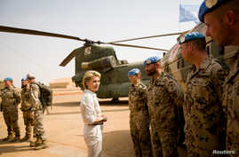 FILE - German Defense Minister Ursula von der Leyen speaks to German army Bundeswehr soldiers during a visit to Camp Castor in Gao, Mali, Dec. 19, 2016.