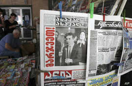 Georgians read newspapers on the street in Tbilisi, Georgia, October 2, 2012.