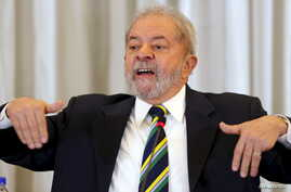 Former Brazilian President Luiz Inacio Lula da Silva reacts as he speaks during a news conference with international media in Sao Paulo, Brazil, March 28, 2016.