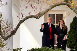 FILE - President Donald Trump waves with outgoing White House Communications Director Hope Hicks before boarding Marine One on the South Lawn of the White House in Washington, March 29, 2018.