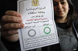 Syrians Vote on New Constitution as Death Toll Mounts
