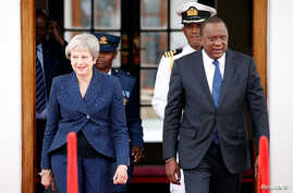 Britain's Prime Minister Theresa May and Kenya's President Uhuru Kenyatta arrive to address a joint news conference at the State House in Nairobi, Kenya, Aug. 30, 2018.