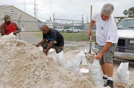 Gulfport, Mississippi, residents shovel sand into bags, preparing for Subtropical Storm Alberto to make its way through the Gulf of Mexico, May 26, 2018.