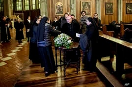 Archbishop Charles Scicluna, center, attends a meeting with priest and nuns at the San Mateo Cathedral in Osorno, Chile, Saturday, June 16, 2018.