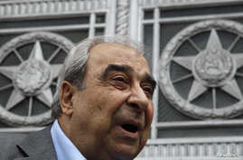 Prominent Syrian opposition activist Michel Kilo talks to the media after a meeting with Russia's Foreign Minister Sergei Lavrov in front of the Foreign Ministry headquarters in Moscow, July 9, 2012.