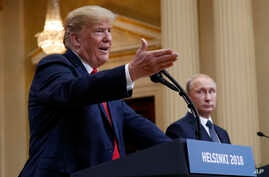 U.S. President Donald Trump, left, gestures while speaking as Russian President Vladimir Putin looks on during their joint news conference at the Presidential Palace in Helsinki, Finland, July 16, 2018.