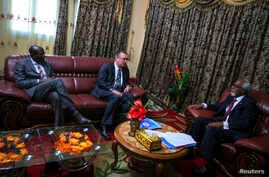 U.N. Under-Secretary General for Political Affairs Jeffrey Feltman (C) talks with the Speaker of the Somali Parliament Osman Jawari (R), at Villa Somalia in the capital Mogadishu, in this handout photo taken and provided by the African Union-United N