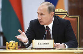 Russia's President Vladimir Putin speaks at the summit of the Commonwealth of Independent States (CIS) in Minsk, Oct. 10, 2014.