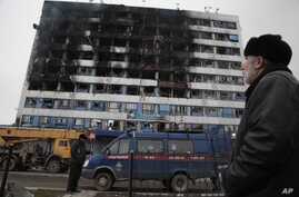 The burned out 'Press House' is seen in central Grozny, Russia, Thursday, Dec. 4, 2014.
