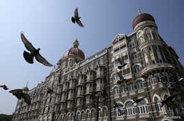 Pigeons fly outside the Taj Mahal Hotel, which was one of the targets of the 26/11 attacks, in Mumbai November 21, 2012. India secretly executed Mohammad Ajmal Kasab, the lone survivor of a Pakistan-based militant squad on Wednesday, just days before