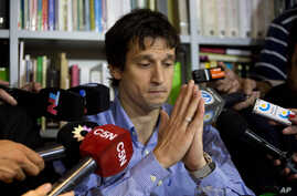 Diego Lagomarsino, an information specialist who gave late prosecutor Alberto Nisman the gun that killed him, speaks to reporters during a press conference in Buenos Aires, Argentina, Jan. 28, 2015.