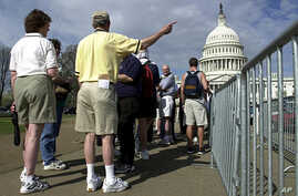 FILE -- Tourists line up outside the U.S. Capitol in Washington.