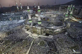 Muslim pilgrims pray around the holy Kaaba at the Grand Mosque, during the annual Hajj pilgrimage in Mecca, Saudi Arabia, Sept. 27, 2014.