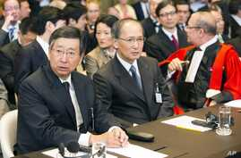 Japanese delegation from left: Deputy Minister of Foreign Affairs Koji Tsuruoka, Ambassador of Japan to the Netherlands Yasumasa Nagamine and Alain Pellet, professor of Paris Ouest University at the International Court of Justice (ICJ) in The Hague,