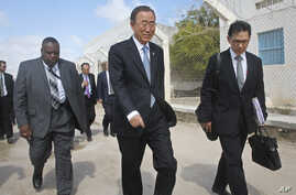 U.N. Secretary-General Ban Ki-moon, center, walks inside the heavily-protected airport complex during a visit to Mogadishu, Somalia, Oct. 29, 2014.