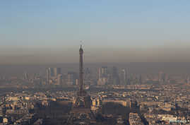A small-particle haze hangs above the skyline, with the Eiffel Tower and the La Defense business district that is seen in the distance, in Paris, France, Dec. 1, 2016.