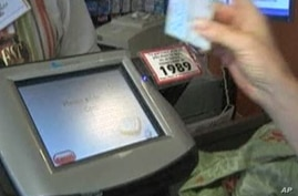 Food stamp recipient pays for groceries in New York