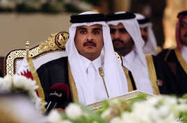 Qatar's Emir Sheikh Tamim bin Hamad Al-Thani attends a Gulf Cooperation Council summit in Doha, Qatar, Dec. 9, 2014.