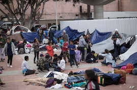 Migrants wait for access to request asylum in the US, at the El Chaparral port of Entry in Tijuana, Mexico, April 30, 2018.