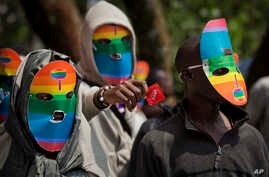 Kenya gay and lesbian activists conceal their identity behind masks to protest a wave of laws against homosexuality in African countries.