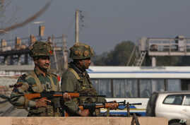 Indian army soldiers take positions outside the Indian airbase in Pathankot, 430 kilometers (267 miles) north of New Delhi, India, Jan. 2, 2016. At least four gunmen entered an Indian air force base near the border with Pakistan early Saturday.