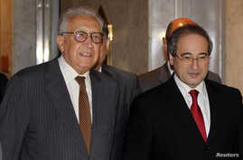Syria's Deputy Foreign Minister Faisal Mekdad (R) welcomes United Nations-Arab League peace envoy for Syria Lakhdar Brahimi (L) upon his arrival at a hotel in Damascus, Syria, September 13, 2012.