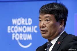 FILE - China's Minister of the National Development and Reform Commission Xu Shaoshi speaks during a session at the World Economic Forum (WEF) in China's port city Dalian, September 9, 2015.
