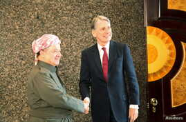 Iraq's Kurdistan region's President Massoud Barzani (L) shakes hands with Britain's Foreign Secretary Philip Hammond in Erbil, Iraq, March 17, 2016.