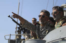 Iran's Navy commander Habibollah Sayyari points while standing on a naval ship during Velayat-90 war game on Sea of Oman near the Strait of Hormuz in southern Iran, Jan. 1, 2012.