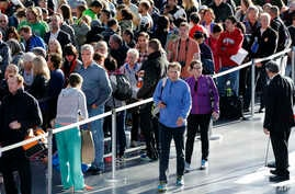 New York City Marathon: Runners line up inside the Jacob Javits Convention Center to register for the New York City Marathon, Friday, Nov. 4, 2016, in New York. The marathon is Sunday.