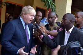 Britain's Foreign Secretary Boris Johnson speaks to media before meeting with Gambian President Adama Barrow for talks in Banjul, Gambia, Feb. 14, 2017.