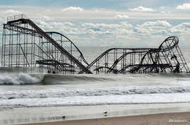 November 1, 2012: The remnants of a roller coaster sits in the surf three days after Hurricane Sandy came ashore in Seaside Heights, New Jersey.
