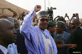 FILE - Nigerian President Muhammadu Buhari gestures as he arrives to cast a vote in Nigeria's presidential election at a polling station in Daura, Katsina State, Nigeria, Feb. 23, 2019.
