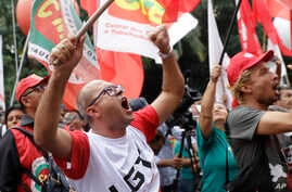 On Feb. 19, 2018, demonstrators protest pension reform proposed by then-President Michel Temer's government in Sao Paulo, Brazil.