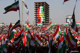 Kurds celebrate to show their support for the upcoming September 25th independence referendum in Erbil, Iraq, Sept. 22, 2017.