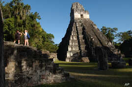 FILE - Tourists are seen at the Mayan ruins of Tikal, 500 kilometers north of Guatemala City, Aug. 20, 2005.