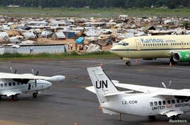 A general view shows United Nations planes in the forefront, with a camp for displaced people in the background at Mpoko airport in Bangui, Central African Republic, May 1, 2014.