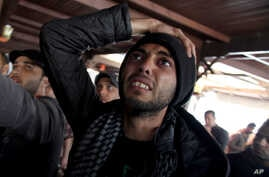 An Egyptian man reacts as he watches a televised court verdict confirming death sentences against 21 people for their role in a deadly 2012 soccer riot, in a coffee shop in Port Said, Egypt, Mar. 9, 2013.