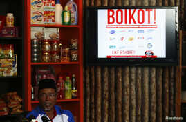 Bazeer Ahmed, a member of Malaysian Muslim Wholesalers and Retailers Association (MAWAR), a non-governmental organization, speaks to journalists during news conference on stopping the supply of Cadbury chocolate products to retail shops, in Kuala Lum