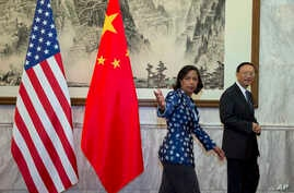 U.S. National Security Advisor Susan Rice, left, gestures as she walks with Chinese State Councilor Yang Jiechi right before a meeting at the Diaoyutai State Guesthouse in Beijing, China, Monday, Sept. 8, 2014.