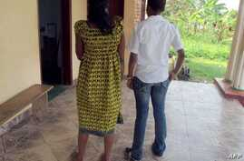 Esther, 29, and Martine, 26 from Yaounde, on trial in Cameroon accused of homosexuality March 15, 2012
