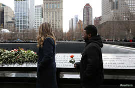 FILE - Attendees wait to leave roses during a commemoration ceremony of the 25th anniversary of the 1993 World Trade Center bombing at the north reflecting pool of the National September 11 Memorial & Museum at the World Trade Center site in the Manh