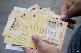 A person shows Powerball tickets she bought on Jan. 12, 2016, in San Lorenzo, Calif.