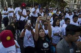 Demonstrators rally in Yangon on Jan. 22, 2017 to denounce the country's controversial sweeping telecommunications law.
