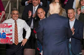 FILE - U.S. Rep. Lou Barletta, R-Pa., left, U.S. Rep. Tom Marino, R-Pa., center left, and U.S. Rep. Scott Perry, R-Pa., right, watch as President-elect Donald Trump, center right, departs a rally in Hershey, Pa., Dec. 15, 2016. Pennsylvania's highest
