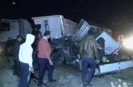A train crashed into two vehicles south of Cairo, killing at least 24 people and wounding 28 others, Nov. 18, 2013.