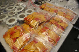 FILE - Confiscated synthetic drugs are seen on display.